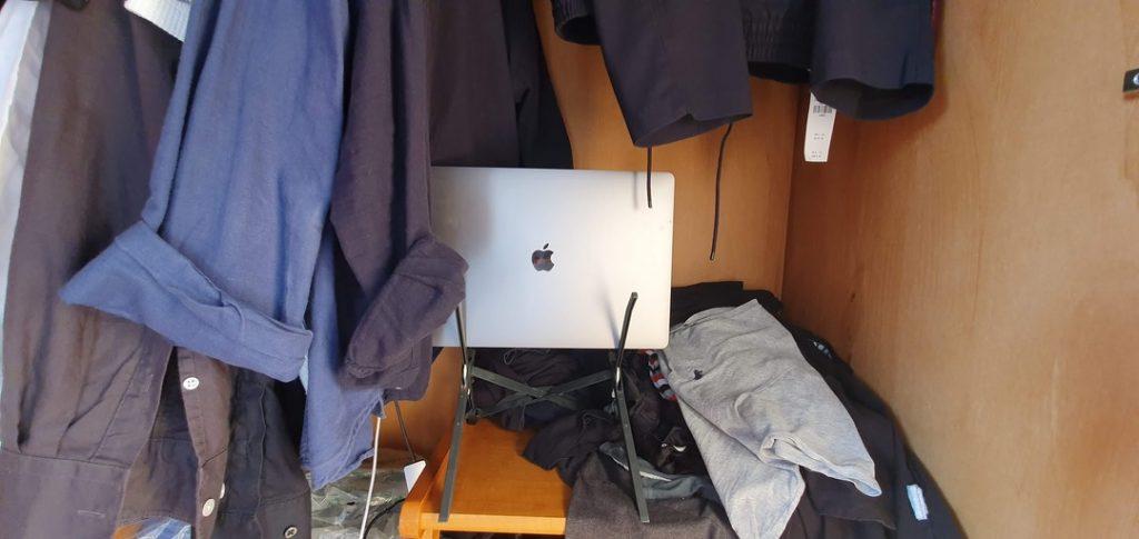 MacBook Pro resting in the wardrobe